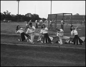 Primary view of object titled '[Cheerleaders Practicing, 1942]'.