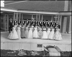 Primary view of object titled '[A Capella Choir Posing for a Photograph on an Outside Stage, November 1960 #1]'.