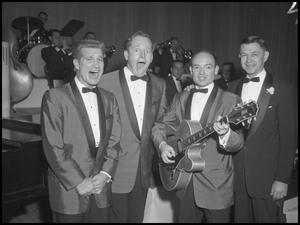 Primary view of object titled '[Singing Group Chuck A Lucks posing with the Host, December 7, 1957]'.