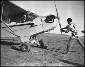 Primary view of object titled '[Two Aviators Preparing for Flight]'.