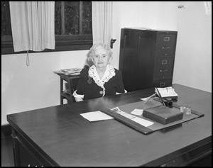 Primary view of object titled '[Dean of Women Edith Clark at her office desk]'.