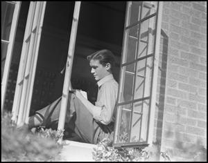 Primary view of object titled '[Male Class Officer Reading a Book near a Window]'.