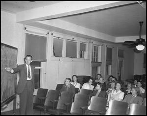Primary view of object titled '[Professor Giving a Lecture to a Class, 1942]'.