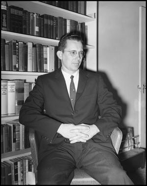 Primary view of object titled '[Dr. Coble Posing in Chair in Suit]'.