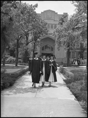 Primary view of object titled '[Commencement - Auditorium - Three Graduates - 1950]'.