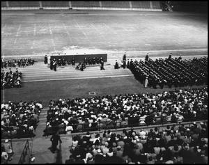 Primary view of object titled '[Commencement - 1961 - Fout's Field - Graduates and Audience]'.
