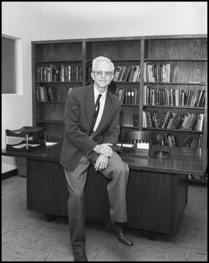 Primary view of object titled '[Physics Department Professor Dr. L.F. Connell Posing in his Office]'.