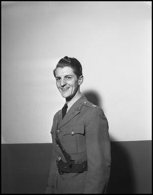Primary view of object titled '[Earl Connette Posing for a Photograph in a Military Uniform]'.