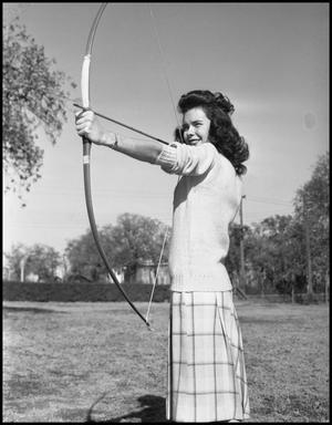 Primary view of object titled '[Cookie Cooper with Bow and Arrow Aiming Left]'.