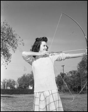 Primary view of object titled '[Cookie Cooper with Bow and Arrow Aiming Right]'.
