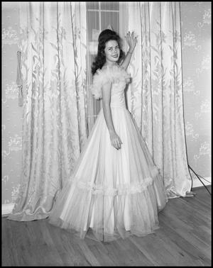 Primary view of object titled '[Cookie Cooper in a Formal Dress near Window]'.