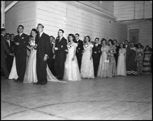 Primary view of object titled '[Formal Couples at a Coronation, 1942]'.