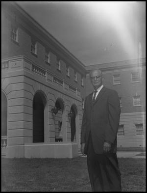 Primary view of object titled 'Curry, O. J. - Business Administration Dept. - Outside Campus Building - Portrait'.