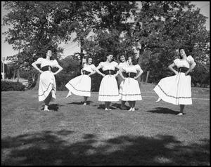 Primary view of object titled '[Six girls dancing on the lawn]'.