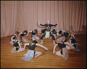 Primary view of object titled '[Dance group performs a routine on stage]'.