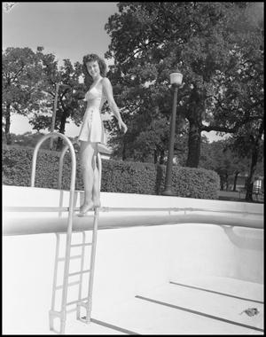 Primary view of object titled '[Woman stands at the edge of a pool]'.