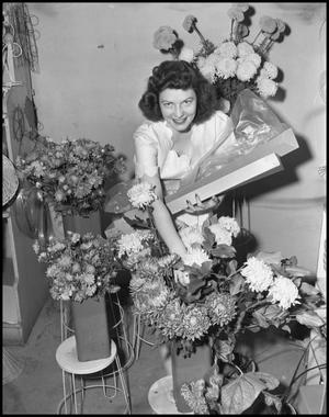 Primary view of object titled '[Woman surrounded by flowers]'.