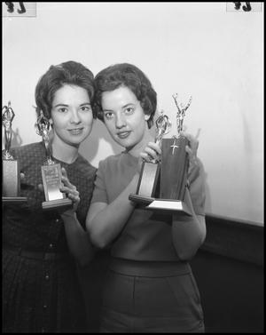 Primary view of object titled '[Two women with trophies]'.