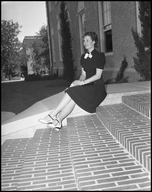 Primary view of object titled '[Woman sits on steps]'.