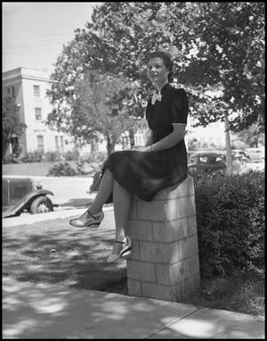 Primary view of object titled '[Woman sits on column]'.
