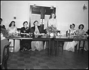 Primary view of object titled '[Women at a formal dinner]'.