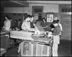 Primary view of object titled '[Students work in a woodshop]'.