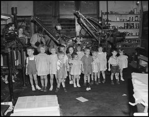 Primary view of object titled '[Children visit a printing press]'.