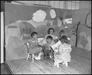 Primary view of object titled '[Children Reading on Stage]'.