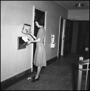 Primary view of object titled '[Female Student Throwing Away Trash]'.