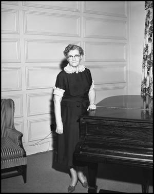 Primary view of object titled '[Bruce Hall dorm mother near piano]'.