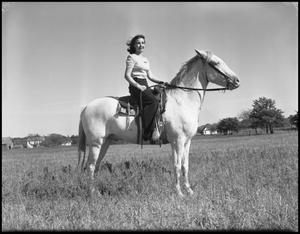 Primary view of object titled '[Anne Douglas Rides Horse]'.