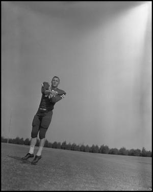 Primary view of object titled '[Football Player Robert Duty Jumping, September 1960]'.