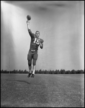 Primary view of object titled '[Football Player Robert Duty Catching a Football Midair, September 1960]'.
