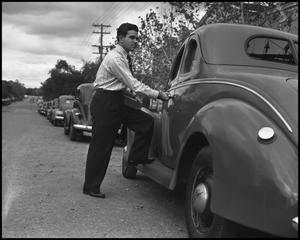 Primary view of object titled '[Man with Car]'.