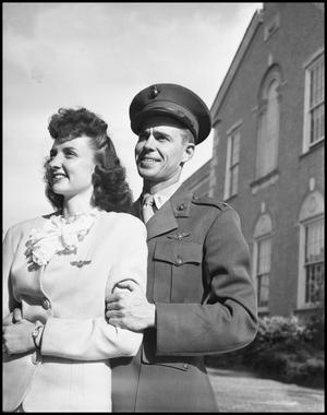 Primary view of object titled '[Woman with Man in Military Uniform]'.