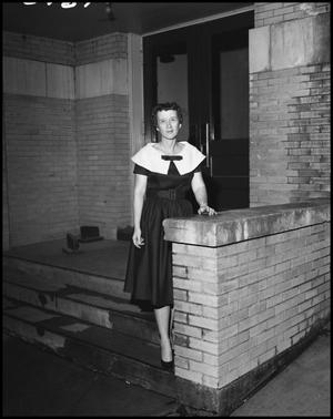 Primary view of object titled '[Woman on Steps]'.