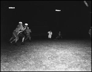 Primary view of object titled '[Football at Night]'.