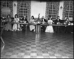 Primary view of object titled '[Fine Arts Committee during an Awards Banquet, 1942]'.