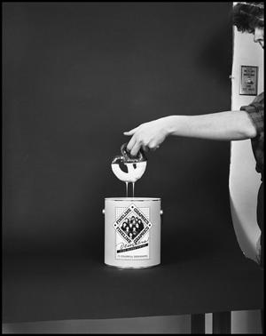 Primary view of object titled '[Female Dips a Pretzel into a Fineline Graphics Gloss Container #7, December 20, 1981]'.