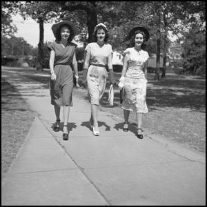 Primary view of object titled '[Lou Love, Winona Ball, and Linda Barbe Walking Outside]'.