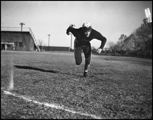 Primary view of object titled '[Football Player Running on the Field]'.