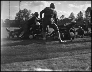 Primary view of object titled '[Football Tackle]'.
