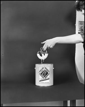 Primary view of object titled '[Female Dips a Pretzel into a Fineline Graphics Gloss Container #9, December 20, 1981]'.