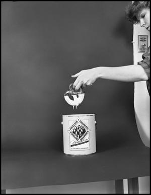 Primary view of object titled '[Woman Dipping a Pretzel in White Paint]'.