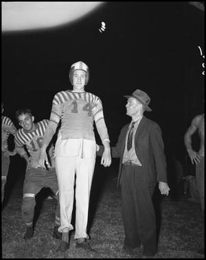 Primary view of object titled '[Football Player with Man]'.
