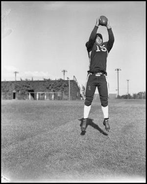Primary view of object titled '[Football Player Catching Ball]'.