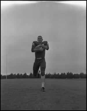 Primary view of object titled '[North Texas State University Jersey No. 44 Football Player, September 1962]'.