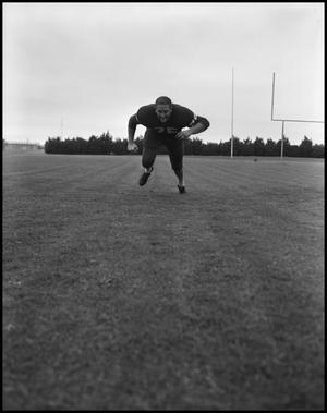 Primary view of object titled '[North Texas State University Jersey No. 25 Football Player Running Low#1, September 1962]'.
