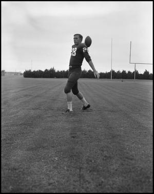 Primary view of object titled '[Football Player No. 28 about to through a Football, September 1962]'.