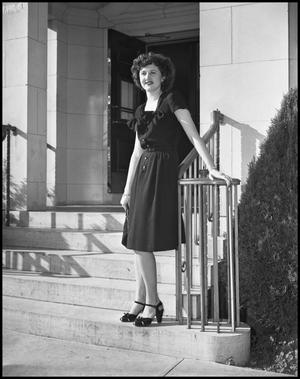 Primary view of object titled '[Mary B. Friend on building steps]'.